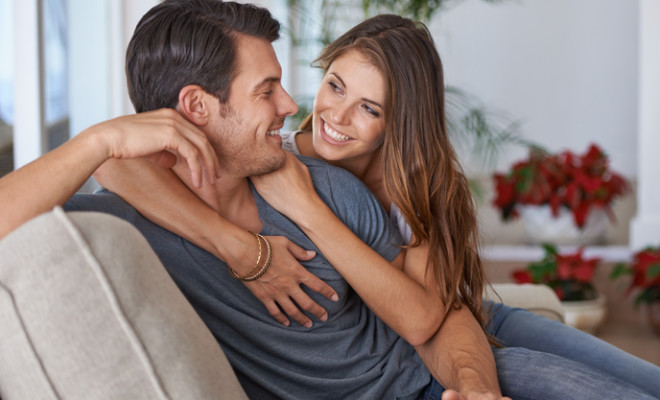An affectionate young couple relaxing at home