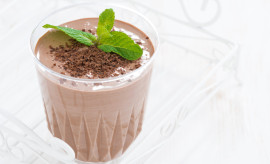chocolate milkshake in a glass on white background, close-up