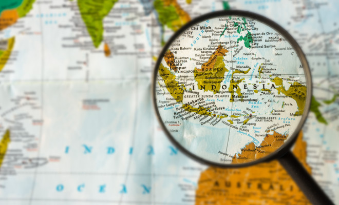Map of Indonesia through magnifying glass