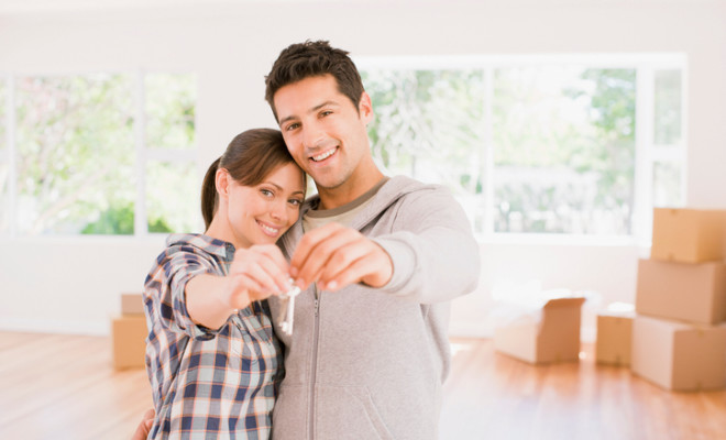 Couple holding the keys to their new house