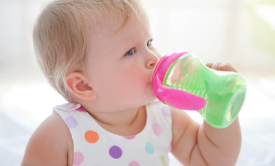 Cute baby drinking water from sippy cup.See more LIFESTYLE and MEDICAL images with this cute BABY an her MOTHER. Click on image below for lightbox.
