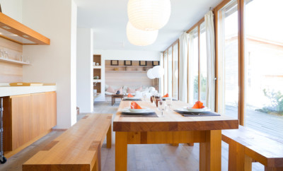 wooden dining table in a modern open kitchen