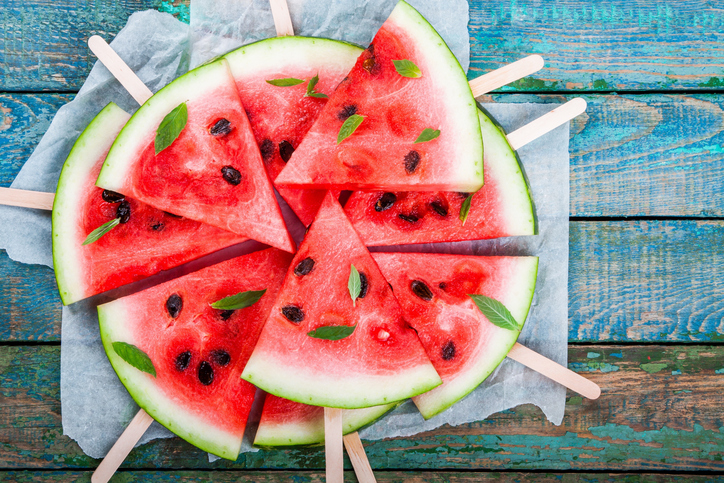 Slices of fresh juicy watermelon on a paper closeup