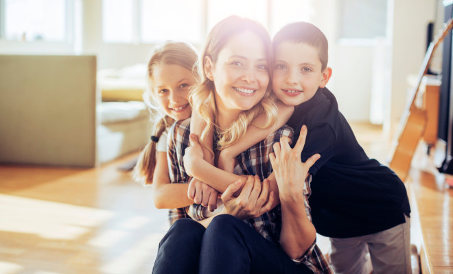 Close up of a happy young family looking at the camera