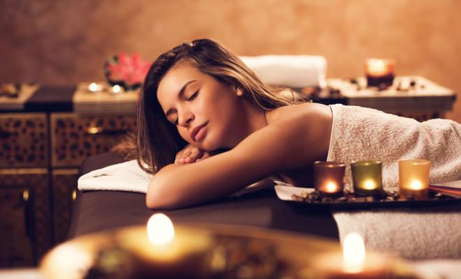 Beautiful young woman enjoying in the spa.