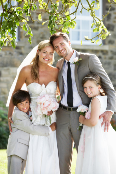 Bride and groom hugging their flower girl and ring bearer