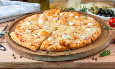 "Pizza ""Four cheeses"" with tomato sauce, artichoke hearts, olives, Parmacotto, fresh mozzarella, parmesan"