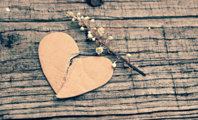 Divorce background with broken heart and message on wooden, unhappy marriage and adultery problem make stress life, society issue in modern lifestyle