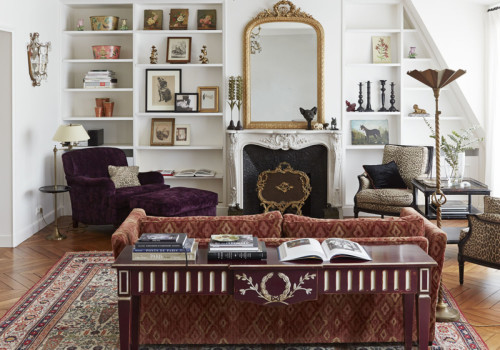 glamorous-traditional-style-living-room-patterned-colorful-area-rug-velvety-armchair-cheetah-print-chairs-fireplace-built-in-shelf-art-gallery-mirror-1-600x420@2x