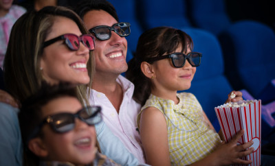 Family at the cinema watching a 3D movie