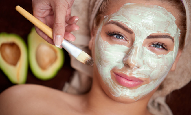 green avocado mask being applied at a beauty spa