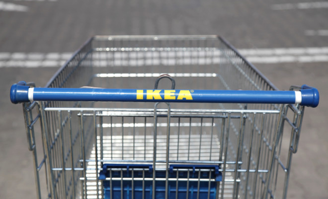 Warsaw, Poland - June 11, 2011: IKEA sign on the shopping cart. IKEA is a Swedish company and the largest furniture retailer in the world.