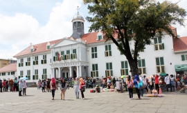 Jakarta, Indonesia: April 6, 2014: The Jakarta Historical Museum, situated in Fatahilah Square in Jakarta's Old Town District, sports Dutch Colonial Architecture, and is a popular stop for tourists to the city.