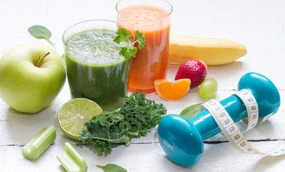 Fruits, vegetables, juice, smoothie and dumbbell health diet and fitness lifestyle concept