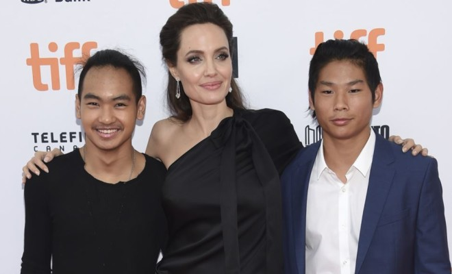 "Maddox Jolie-Pitt, from left, Angelina Jolie and Pax Jolie-Pitt attend a premiere for ""First They Killed My Father"" on day 5 of the Toronto International Film Festival at the Princess of Wales Theatre on Monday, Sept. 11, 2017, in Toronto. (Photo by Evan Agostini/Invision/AP)"