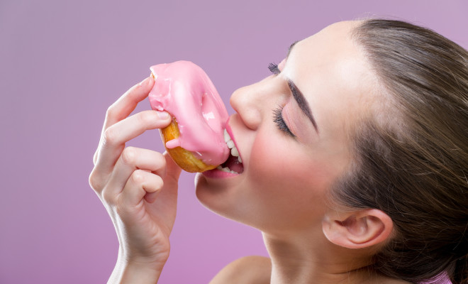 Beautiful sensual woman, eat a donut