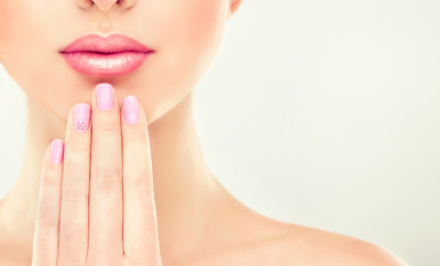 Beauty Spa and cosmetics Woman Portrait. Beautiful Girl with pink manicure on the nails and soft tender lips.