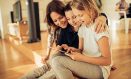 Photo of a family using a digital tablet