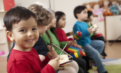 Little boys portrait.A group of preschool children in a music class.