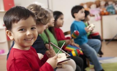 Little boys portrait.A group of preschool children in a music class.