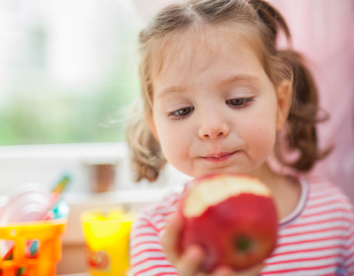 little cute girl eating apple
