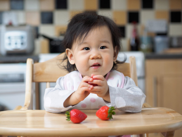baby girl eating freshness strawberry  first time