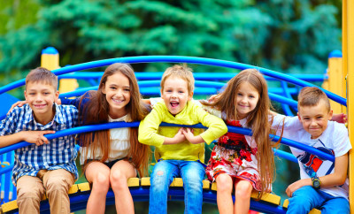 group of happy kids having fun on playground