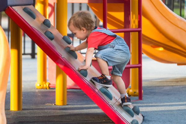 Male Toddler Playing at the playground