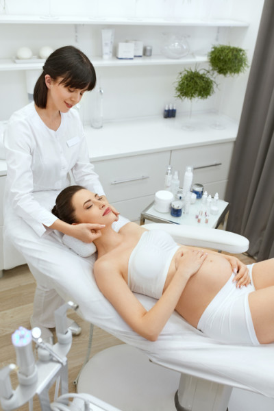 Face Cosmetology. Facial Massage For Pregnant Woman At Clinic