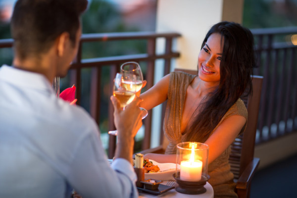 Couple having intimate dinner of summer evening