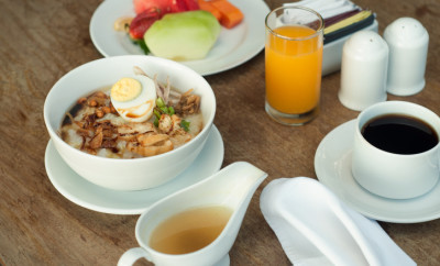 Chicken Porridge is a common breakfast menu in Indonesia and almost of soth east and east asia. it's a rice cooked with plenty of chicken broth, served with chicken, egg and some peanuts