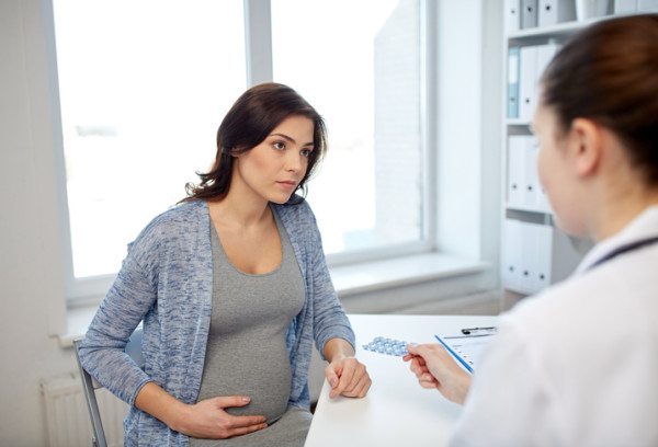 gynecologist doctor and pregnant woman at hospital