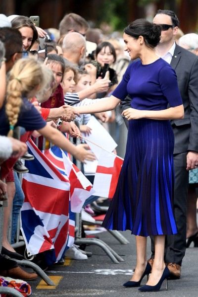 meghan-duchess-of-sussex-takes-part-in-a-walkabout-on-news-photo-1055712352-1541082157 (1)