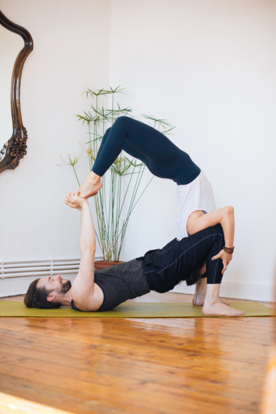 Young couple exercising yoga at home