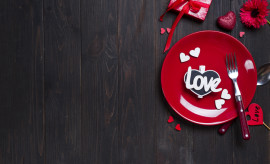 Romantic table setting for Valentines day with letter Love on dark wooden background, flat lay copy space