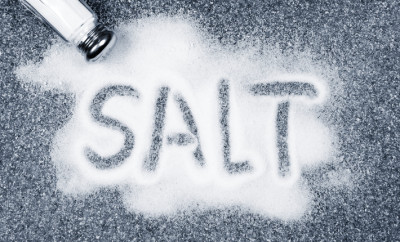 Salt written on counter in spilled salts from shaker