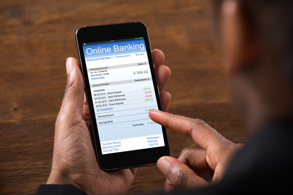 Businesswoman Using Online Banking Service On Mobile Phone