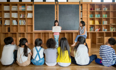 Young school girl giving a presentation in class. Okayama, Japan